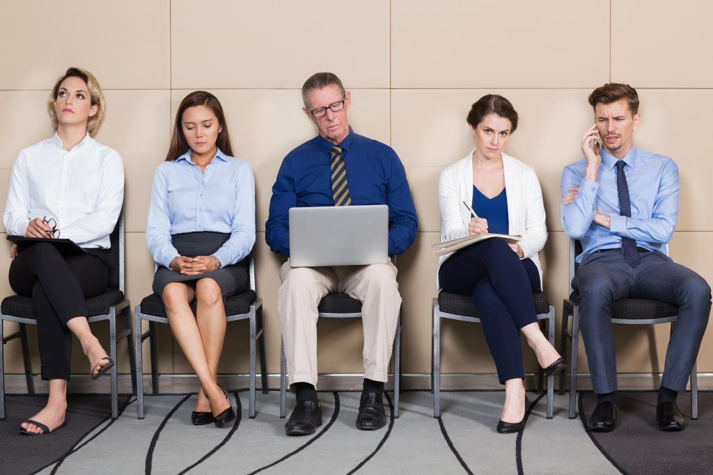 Men and Women Sitting and Waiting for Interview